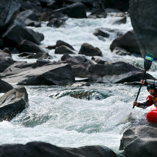 A kayaker runs a drop on Tumwater Canyon, outside of Leavenworth, Washington- Eric Mickelson Photo.