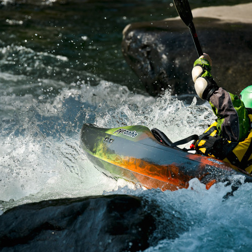 A kayaker run a drop in the morning light on Tumwater Canyon, outside of Leavenworth, Washington- Eric Mickelson Photo.