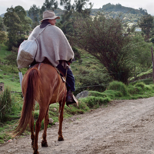 A horseman rides along a road near Mongui, Colombia.