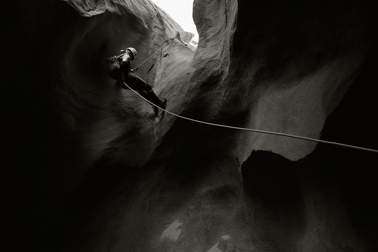 Amy on one of a handful of rappels in Leprechaun Canyon. © Eric Mickelson